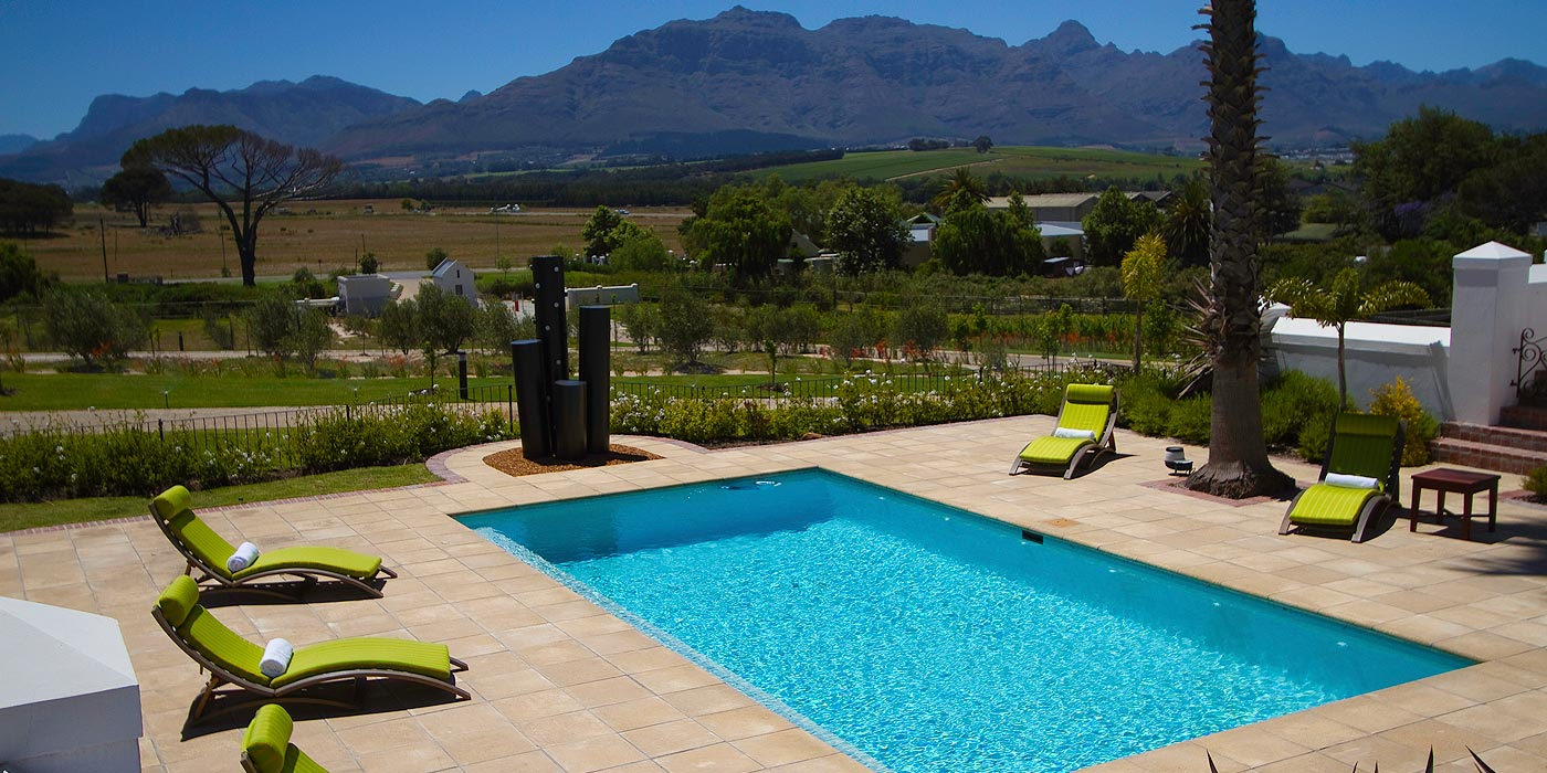 Stellenbosch Guest House accommodation pool and view of mountains